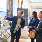 An exhibiter demonstrating his latest safety innovation to attendees