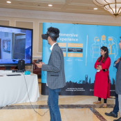 Attendees experiencing a virtual reality program during tea break